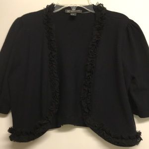 INC black crop sweater with lace ruffle trim.